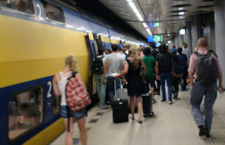 Amsterdam Schiphol Airport Train Station And People Boarding Train In The Netherlands.Europe